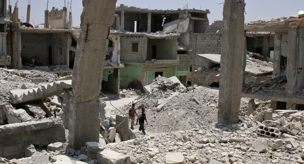 Men walk over rubble of damaged buildings in the province of Daraa, Syria July 11, 2017
