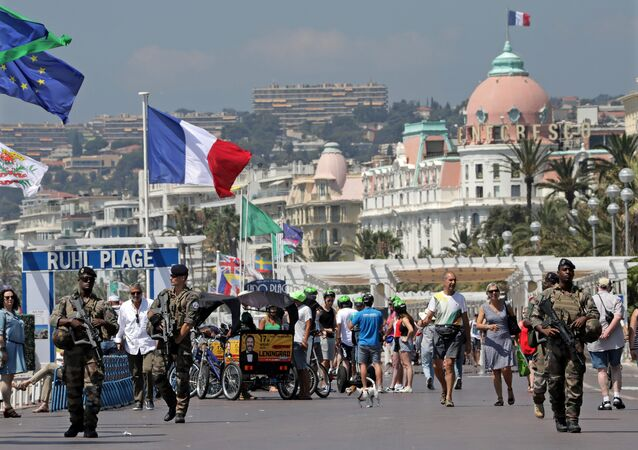Armed French soldiers patrol along the Promenade des Anglais on the eve of the memorial ceremony of the July 14 fatal truck attack in Nice, France, July 13, 2017.