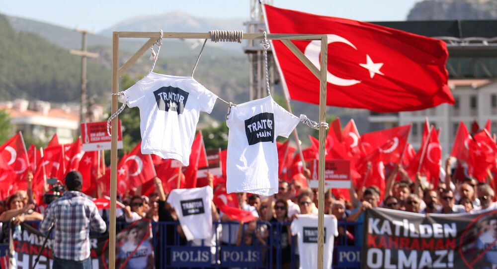 Supporters of President Tayyip Erdogan wave Turkish flags as shirts hung on gallows are seen in the foreground during a trial for soldiers accused of attempting to assassinate the president on the night of the failed last year's July 15, 2016 coup, in Mugla, Turkey July 14, 2017.