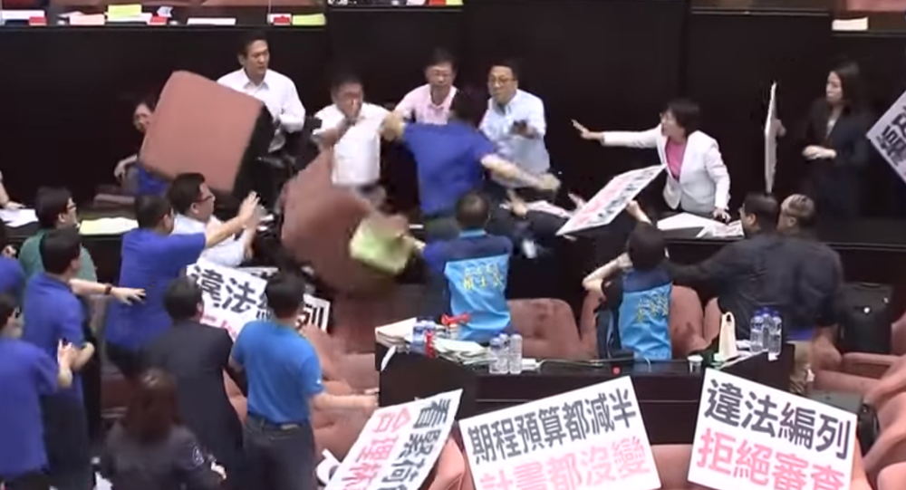 Taiwan's legislators were embroiled in parliament brawl for a second consecutive day on Friday, July 14, 2017.