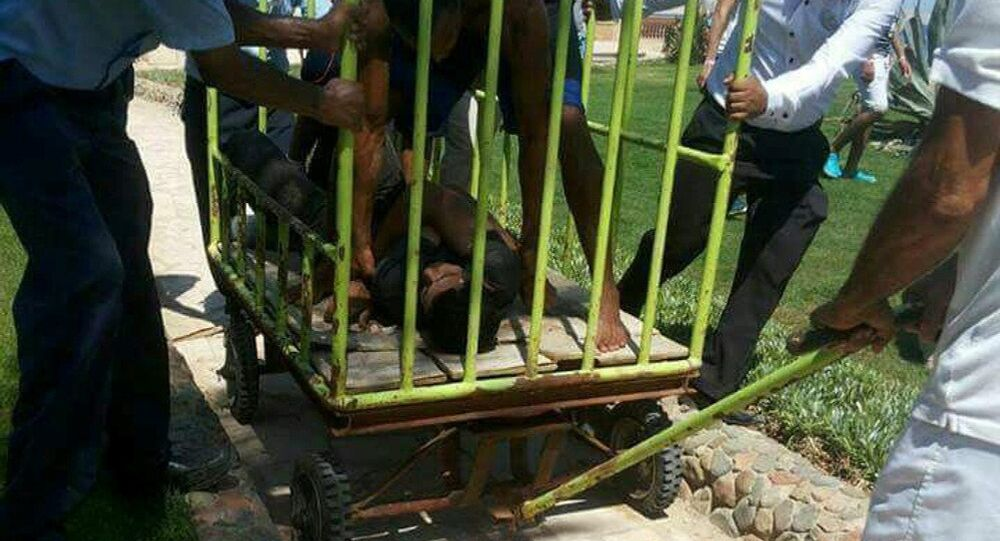 Workers and security detain the man who stabbed two German tourists to death and wounded four others during an attack of the Zahabia hotel resort in Hurghada, south of the capital Cairo, Egypt, July 14, 2017