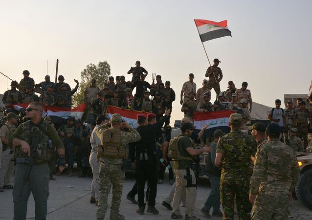 Iraqi security forces celebrate as Prime Minister Haider al-Abadi announces victory over Islamic State in Mosul, in Mosul, Iraq July 10, 2017