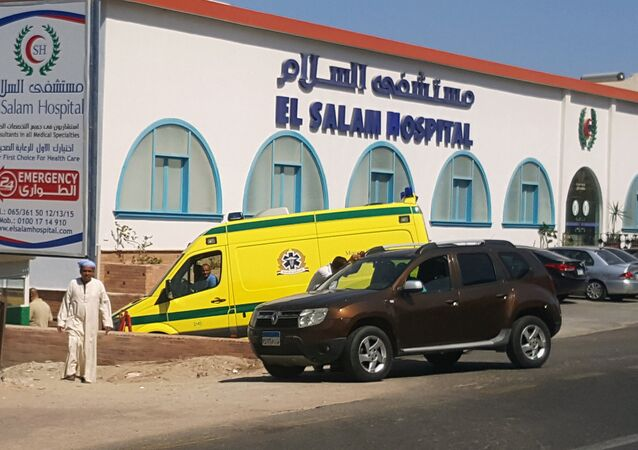 A man walks in front of an ambulance arriving at El Salam Hospital after an Egyptian man stabbed two German tourists to death and wounded four others at the beach of the Zahabia hotel, in Hurghada, south of the capital Cairo, Egypt, July 14, 2017