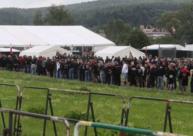 Neo-Nazis stand in line to enter a concert in Themar, eastern Germany on July 15, 2017