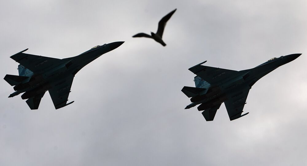 Su-27 Flanker fighters fly over Palace Square in during a rehearsal of the Victory Parade in St. Petersburg