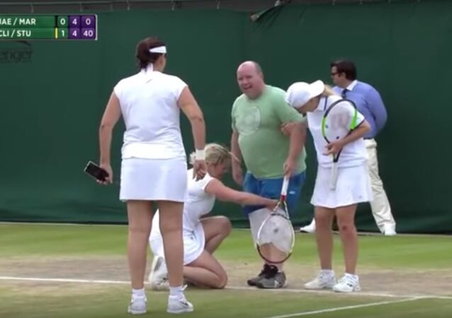 Wimbledon fan pulls on a white skirt to face a Kim Clijsters serve