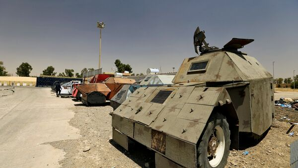 Vehicles used for suicide car bombings, made by Islamic State militants, are seen at Federal Police Headquarters after being confiscated in Mosul, Iraq July 13, 2017 - Sputnik International