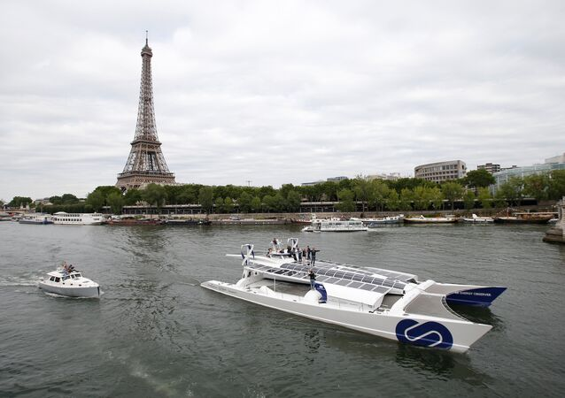 Energy Observer, the first self-sustainable eco-friendly boat, travels on the Seine river next to the Eiffel tower as it leaves for a world tour, in Paris, France July 15, 2017