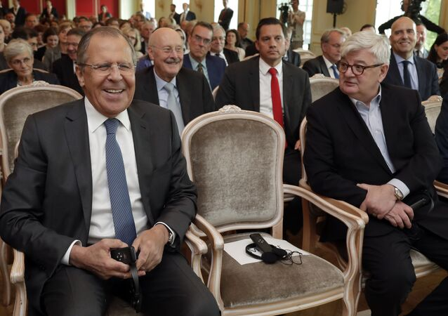 Russia's Foreign Minister Sergey Lavrov, left, smiles as he sits beside former German Foreign Minister Joschka Fischer, right, prior to an event of the Koerber Foundation in Berlin, Germany, Thursday, July 13, 2017