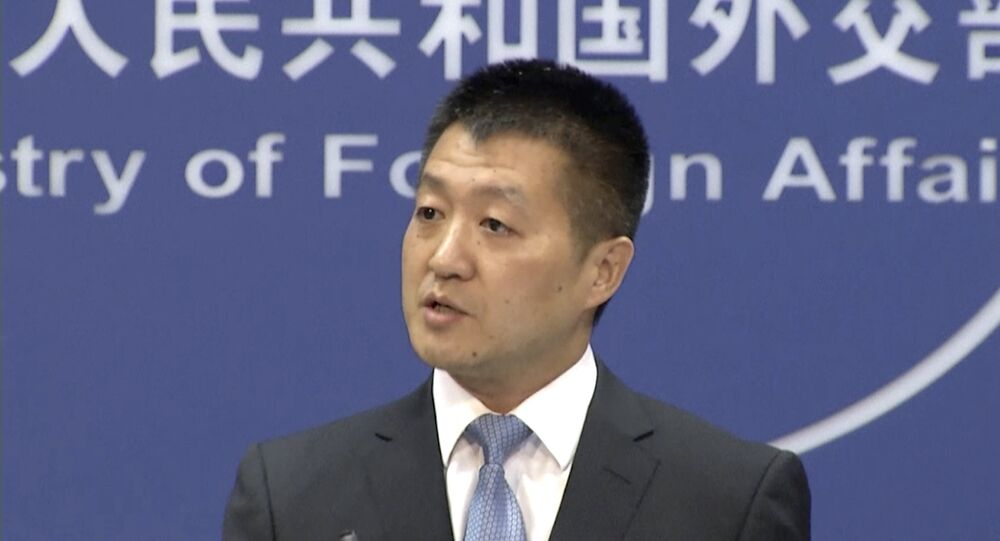 In this July 12, 2016 file image made from video, Lu Kang, the most senior spokesman of China's Foreign Affairs Ministry, speaks to reporters about the international tribunal's ruling on the South China Sea during a news briefing in Beijing