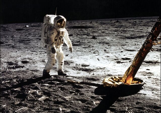 This photo taken 20 July 1969 of astronaut Edwin Buzz E. Aldrin Jr., lunar module pilot walking on the surface of the moon near the leg of the Lunar Module (ML) Eagle during the Apollo 11 extravehicular activity (EVA). Astronaut Neil A. Armstrong took this photograph with a 70mm lunar surface camera.