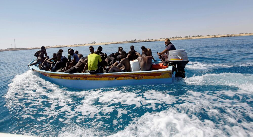 Migrants ride in a boat after they were rescued by Libyan coastguard off the coast of Gharaboli, east of Tripoli, Libya July 8, 2017
