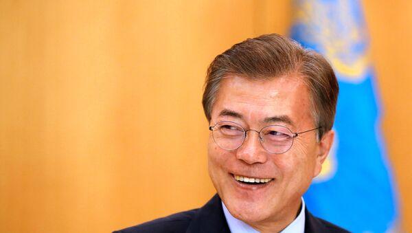 South Korean President Moon Jae-in smiles during Reuters interview in Seoul. - Sputnik International