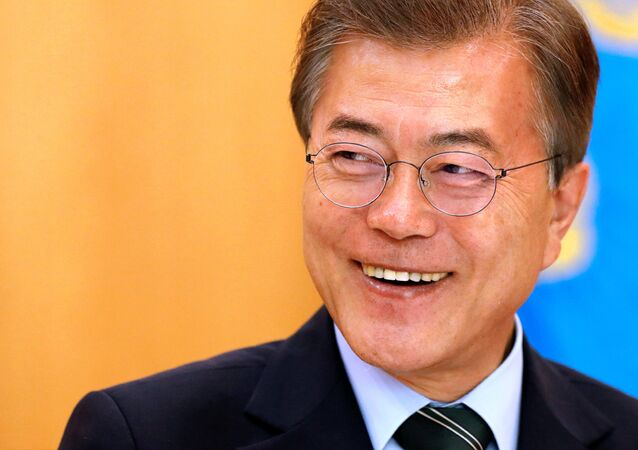 South Korean President Moon Jae-in smiles during Reuters interview in Seoul.