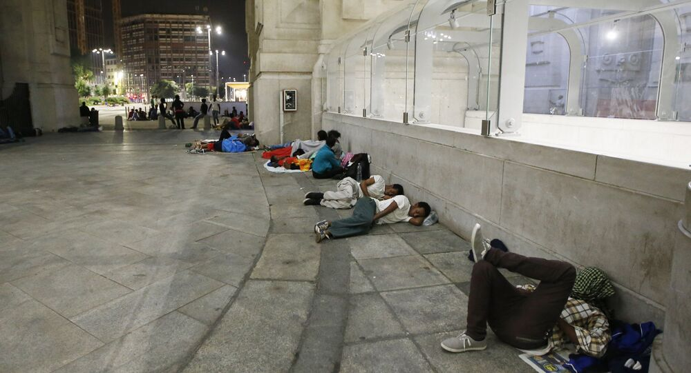 Migrants rest and sleep outside Milan's main train station, Italy (File)