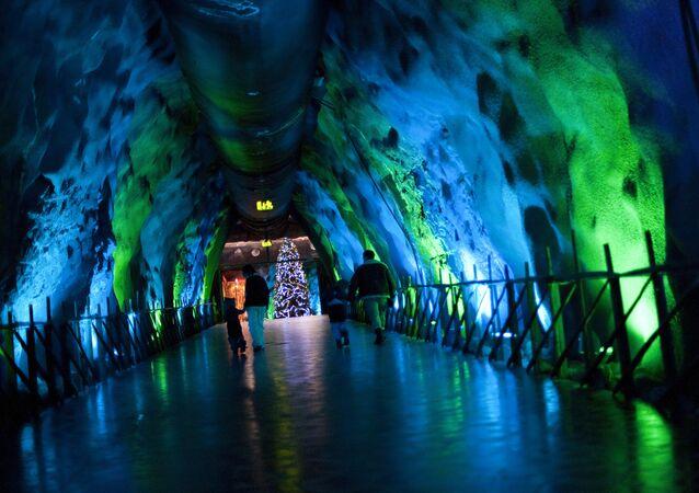 A family walks in an underground tunnel in Santa Park near Rovaniemi, Finnish Lapland, on December 14, 2011.