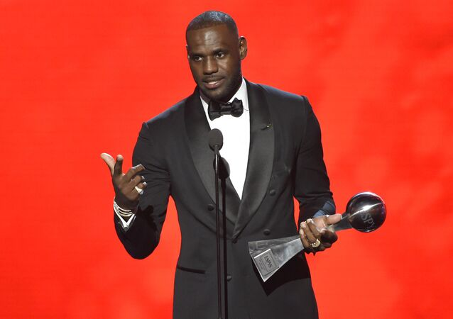 NBA basketball player LeBron James, of the Cleveland Cavaliers, accepts the award for best male athlete at the ESPY Awards at the Microsoft Theater on Wednesday, July 13, 2016, in Los Angeles.