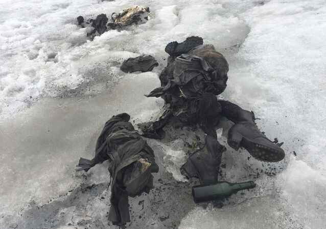 In this photo released by the Swiss train company ' Glacier 3000' shoes and clothing are visible at a Swiss glacier where two bodies were found.