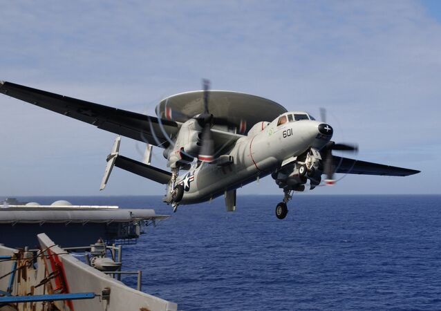 The E-2C is an all weather, carrier-based tactical warning/control system aircraft, providing airborne early warning and control functions for the strike group.