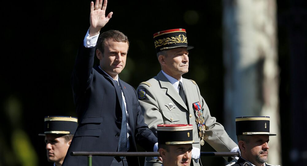 French President Emmanuel Macron and Chief of the Defence Staff French Army General Pierre de Villiers arrive in a command car for the traditional Bastille Day military parade on the Champs-Elysees in Paris, France, July 14, 2017.