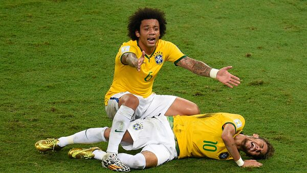 Brazil's defender Marcelo (back) reacts over Brazil's forward Neymar after he was injured following a tackle during the quarter-final football match between Brazil and Colombia at the Castelao Stadium in Fortaleza during the 2014 FIFA World Cup on July 4, 2014. - Sputnik International