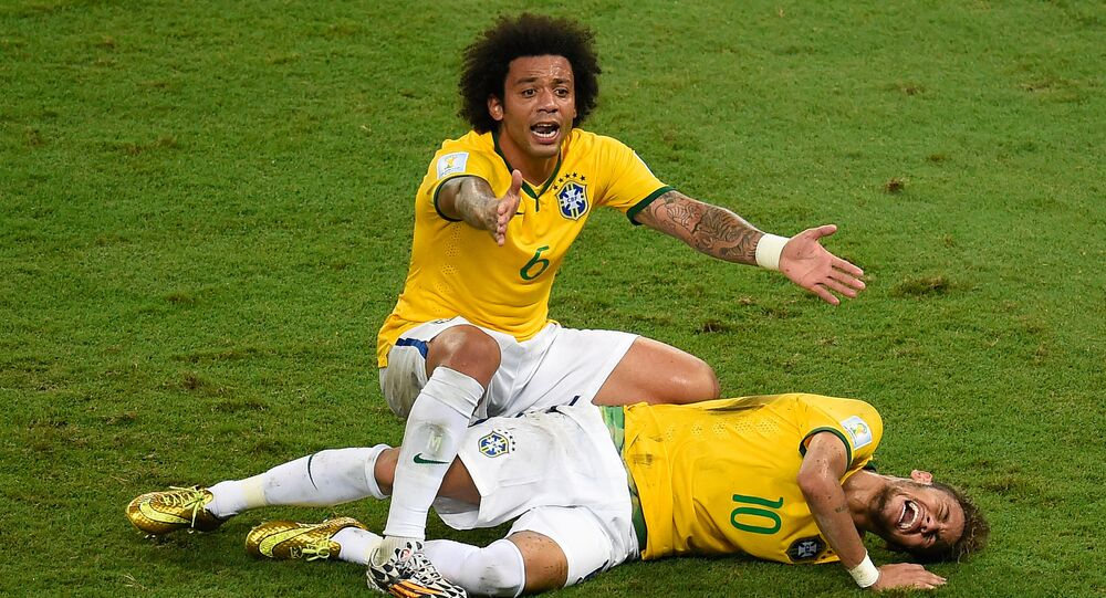 Brazil's defender Marcelo (back) reacts over Brazil's forward Neymar after he was injured following a tackle during the quarter-final football match between Brazil and Colombia at the Castelao Stadium in Fortaleza during the 2014 FIFA World Cup on July 4, 2014.