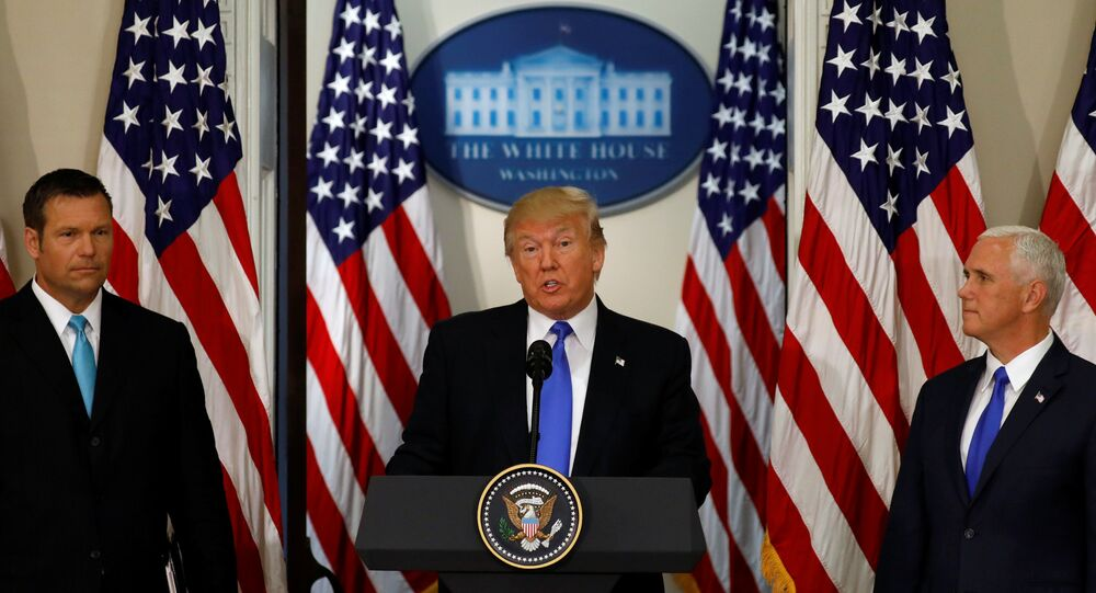 U.S. President Donald Trump speaks at the first meeting of the Presidential Advisory Commission on Election Integrity co-chaired by Kansas Secretary of State Kris Kobach (L) and Vice President Mike Pence (R) at the White House in Washington, U.S., July 19, 2017.