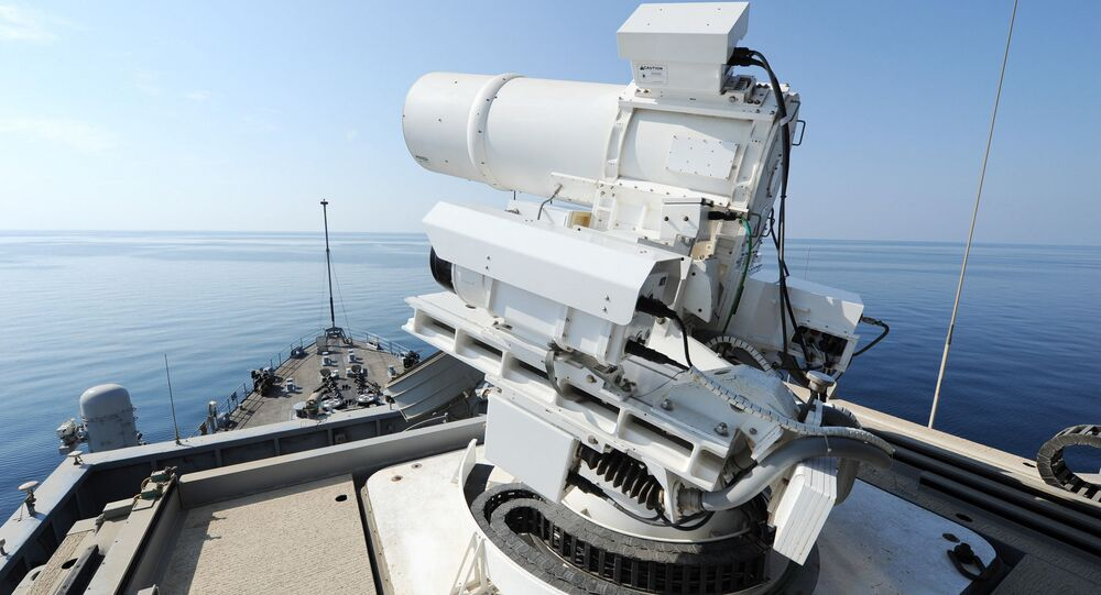 The Afloat Forward Staging Base (Interim) USS Ponce (ASB(I) 15) conducts an operational demonstration of the Office of Naval Research (ONR)-sponsored Laser Weapon System (LaWS) while deployed to the Arabian Gulf.