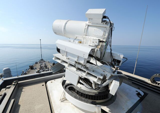 The Afloat Forward Staging Base (Interim) USS Ponce (ASB(I) 15) conducts an operational demonstration of the Office of Naval Research (ONR)-sponsored Laser Weapon System (LaWS) while deployed to the Gulf. File photo