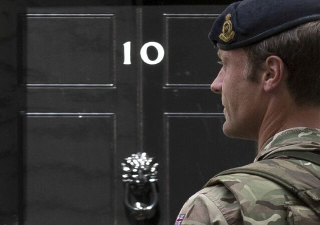 An armed member of the British Army patrols outside 10 Downing Street, London.