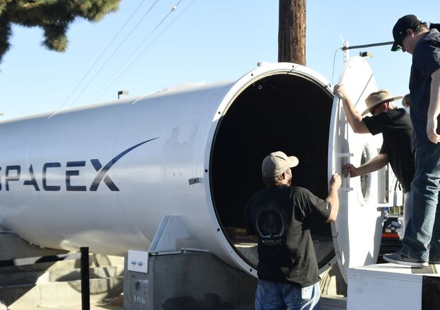 Workes close the door on the SpaceX Hyperloop tube during the SpaceX Hyperloop competition in Hawthorne, California on January 29, 2017.