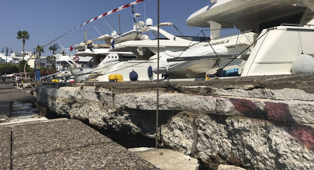 The broken quay wall is raised by several inches in the harbor after an earthquake in Kos on the island of Kos, Greece Friday, July 21, 2017. Greek authorities said two tourists killed in the overnight quake are from Turkey and Sweden.