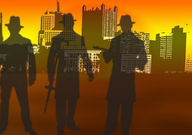 Silhouettes of men holding weapons