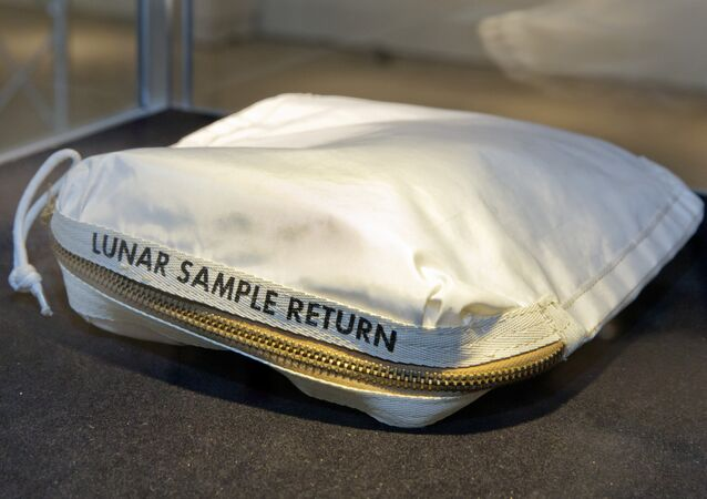 The Apollo 11 Contingency Lunar Sample Return Bag used by astronaut Neil Armstrong, to be offered at auction, is displayed at Sotheby's, in New York. The bag containing traces of moon dust is heading to auction - surrounded by some fallout from a galactic court battle.