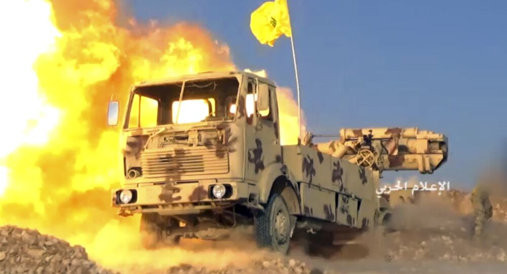 This frame grab from video released on Friday, July 21, 2017 and provided by the government-controlled Syrian Central Military Media, shows a Hezbollah cannon pounding militants' positions on the Lebanon-Syria border
