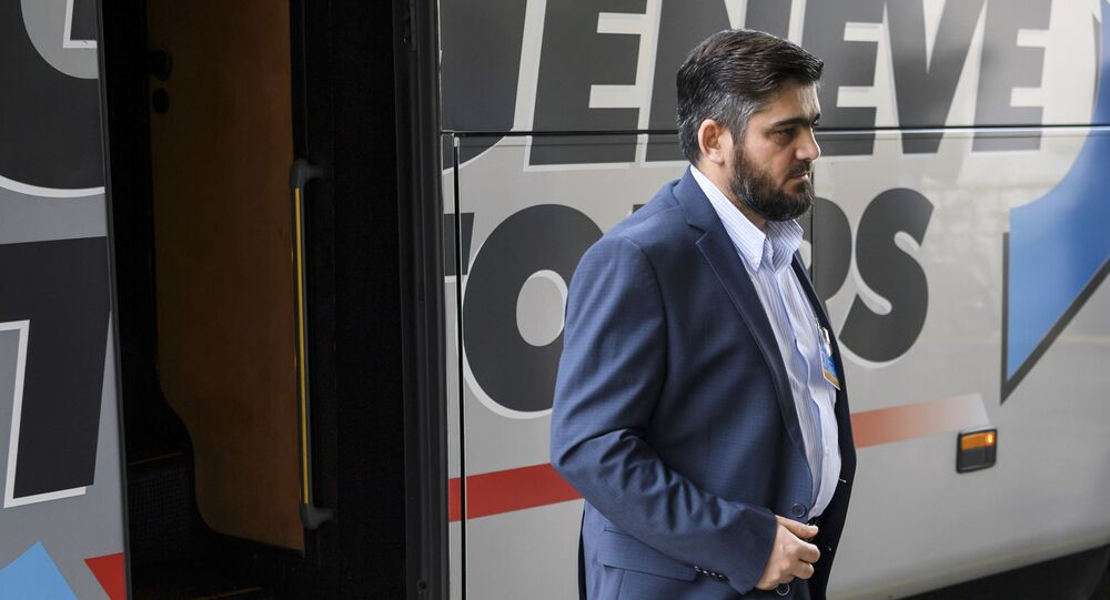 Member of the Syrian opposition and member of the High Negotiations Committee (HNC) Mohammed Alloush arrives for a meeting with the UN Special Envoy for Syria Staffan de Mistura during peace talks, Friday, May 19, 2017, at the United Nations Offices in Geneva, Switzerland