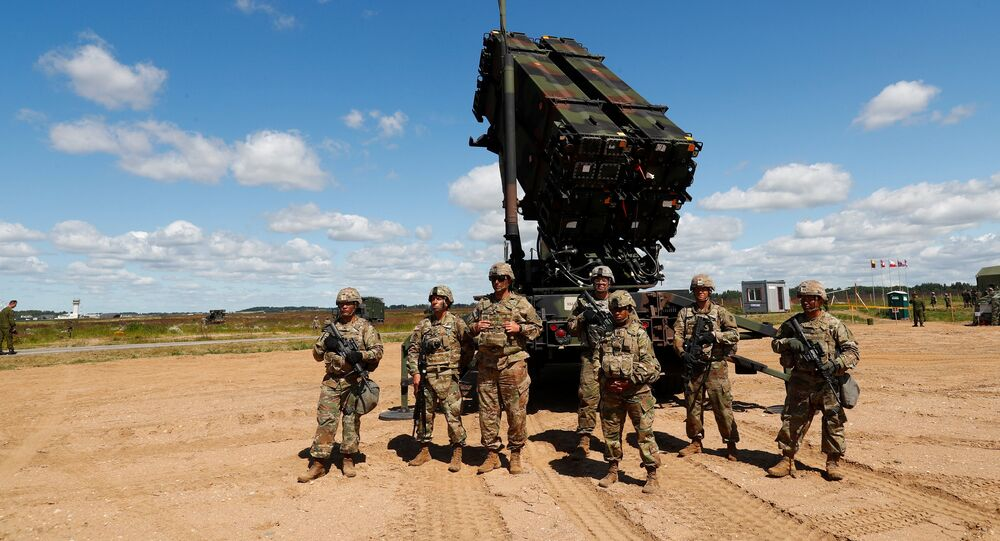 US soldiers stand next to the long-range air defence system Patriot during Toburq Legacy 2017 air defence exercise in the military airfield near Siauliai, Lithuania, July 20, 2017