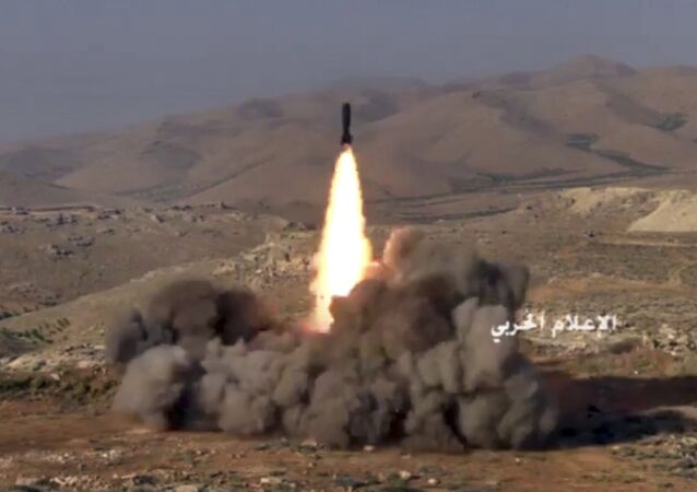This frame grab from video released on Saturday, July 22, 2017 and provided by the government-controlled Syrian Central Military Media, shows Hezbollah fighters firing a missile at positions of al-Qaida-linked militants in an area on the Lebanon-Syria border