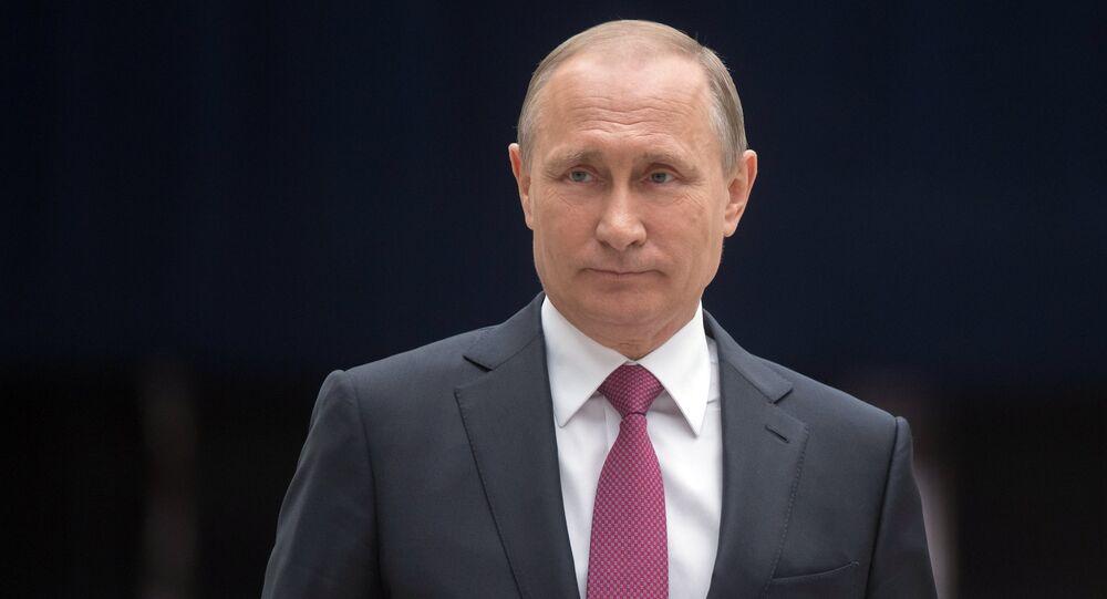 Russian President Vladimir Putin answers journalists' questions