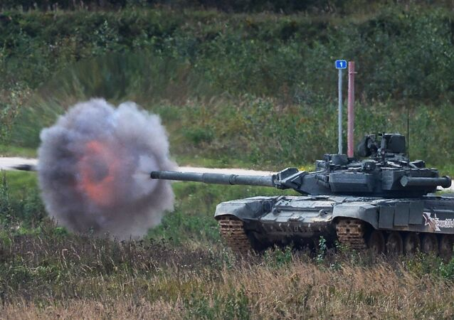 A T-90 tank shoots during a demo exercise at Alabino base (File)