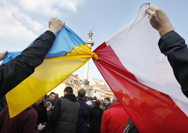 People hold tied Polish, right, and Ukrainian flags during a demonstration supporting the opposition movement in Ukraine, in Warsaw, Poland, Sunday, Feb. 23, 2014