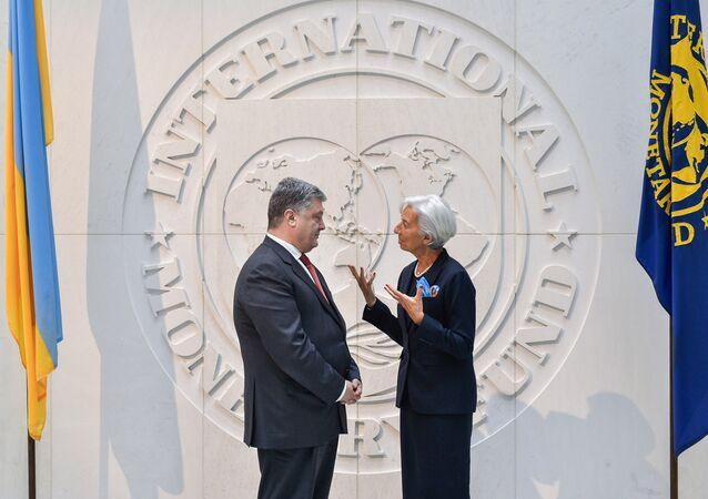 President Petro Poroshenko and Christine Lagarde, Managing Director of the International Monetary Fund, at a meeting. The image is a handout provided by a third party