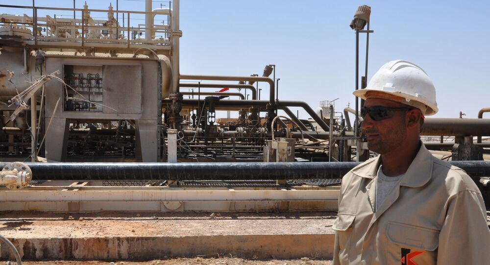 A picture taken on July 9, 2017 shows an employee standing at Syria's Arak gas field, 35 kilometres (20 miles) northeast of the ancient city of Palmyra, in the central province of Homs, a few weeks after it was retaken by government forces from the hands of jihadists of the Islamic State group