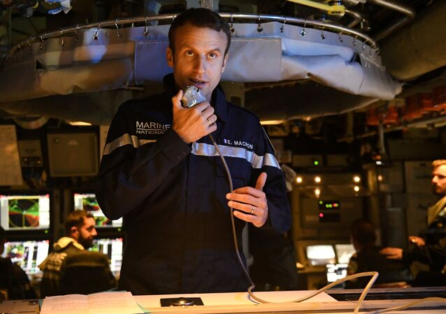 French president Emmanuel Macron speaks to the Captain and crew of the submarine Le Terrible from the operations centre of the vessel, whilst at sea on July 4, 2017