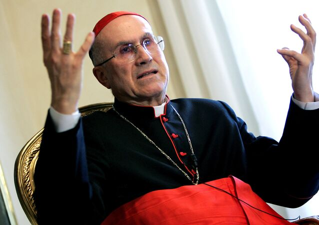 Italian Cardinal Tarcisio Bertone, the prelate leading the Vaticans charge against The Da Vinci Code, speaks during an interview with Reuters at the Vatican March 16, 2005.