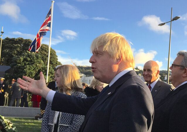 British Foreign Secretary Boris Johnson talks with officials during an official ceremony at the Pukeahu National War Memorial Park in Wellington, New Zealand.