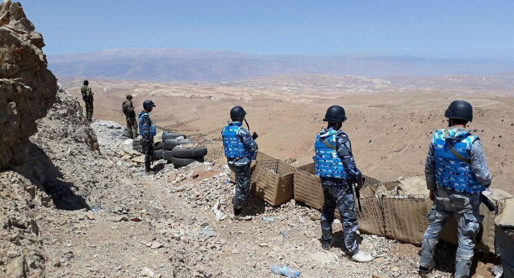 Fighters from the Syrian army units and Hezbollah are seen on the western mountains of Qalamoun, near Damascus, in this handout picture provided by SANA on July 23, 2017, Syria