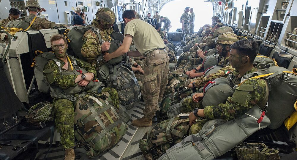 Paratroopers prepare for deployment onboard a US aircraft during the Swift Response 2017 international military exercise at Papa Airbase near Papa, 146 kms southwest of Budapest, Hungary, Tuesday, July 18, 2017. Swift Response is part of the Saber Guardian 2017 (SG17) multinational military exercise held annually in the Black Sea Region as part of the U.S. European Command Joint Exercise Program. The lead organizations for Saber Guardian 2017 are U.S. Army Europe and the Bulgarian Armed Forces. SG17 is co-hosted by the Bulgarian, Hungarian and Romanian land force components and it takes place in numerous locations across Bulgaria, Hungary and Romania in the summer of 2017