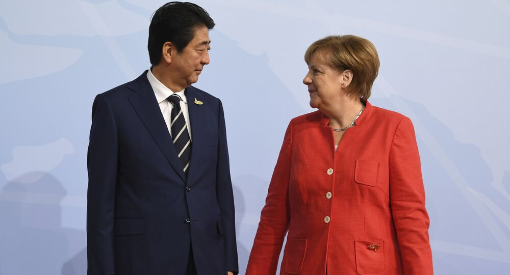 German chancellor Angela Merkel welcomes Japan's Prime Minister Shinzo Abe at the start of the G-20 meeting in Hamburg, northern Germany, on Friday, July 7, 2017.