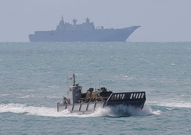 Soldiers from the Australian Army's 3rd Brigade and two troop carriers are brought on a landing craft from HMAS Canberra (background) to Langham Beach during the Talisman Saber joint military exercises between Australia and the United States , July 2017.